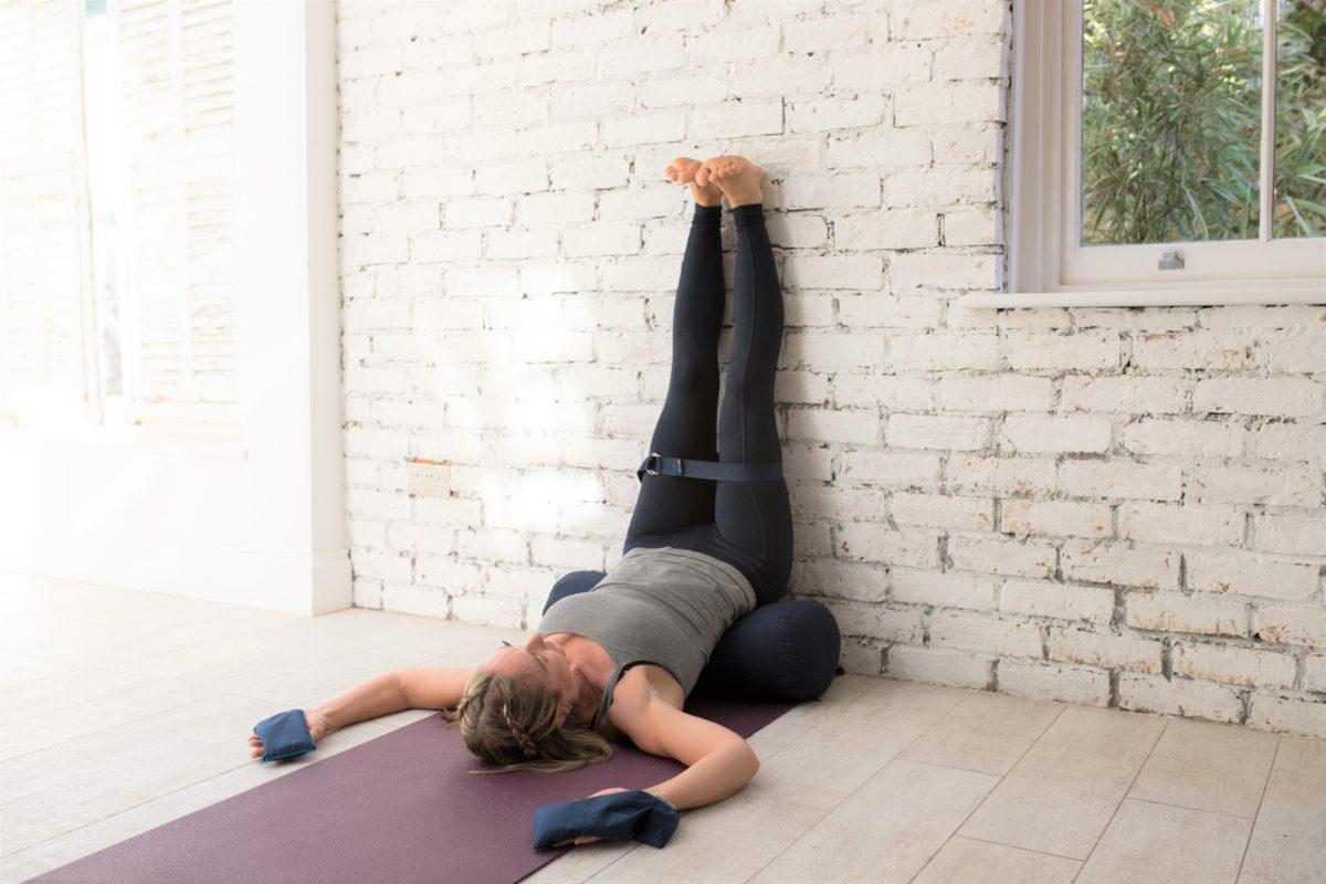 legs-up-wall-yoga-pose-bolster